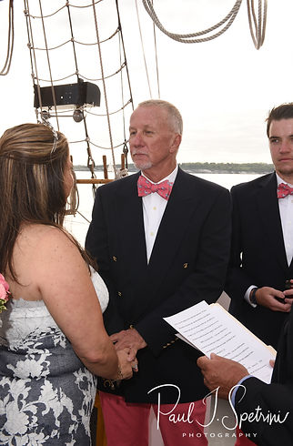Mike looks at Kate during his May 2018 wedding ceremony aboard the Schooner Aurora boat in the waters off Newport, Rhode Island.