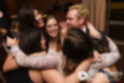 Kristin is hugged by friends during her October 2016 wedding reception at the Ashworth by the Sea Hotel in Hampton, New Hampshire.