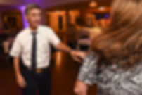 Guests dance during Beth & Bryan's August 2018 wedding reception at McGovern's on the Water in Fall River, Massachusetts.