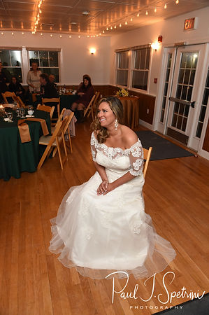 Cara waits to have her garter removed during her November 2018 wedding reception at the North Beach Clubhouse in Narragansett, Rhode Island.