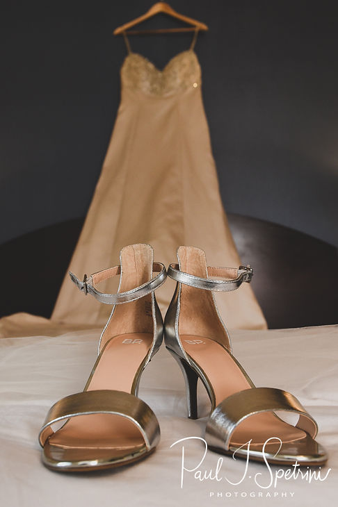 A look at Meghan's dress and shoes at the Biltmore in Providence, Rhode Island prior to her September 2018 wedding ceremony at Immaculate Conception Church in Cranston, Rhode Island.