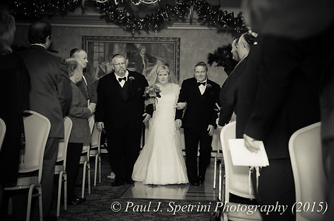 Cathy walks down the aisle during her and Ron's December 2015 wedding at Quidnessett Country Club in North Kingstown, Rhode Island.