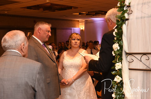 Robin and Rick listen as their officiant speaks during their August 2018 wedding ceremony at Twelve Acres in Smithfield, Rhode Island.
