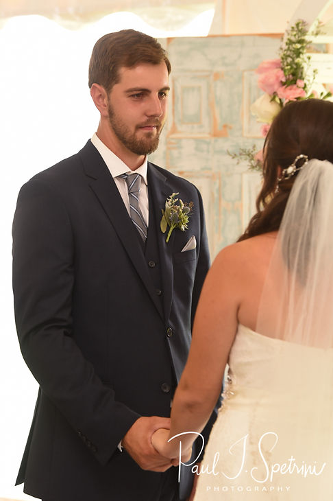 Ethan looks at Karolyn during his August 2018 wedding ceremony at a private residence in Sterling, Connecticut.