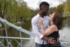 Courtnie and Richie pose for a photo on a bridge in the Boston Public Gardens during their May 2018 engagement session in Boston, Massachusetts.