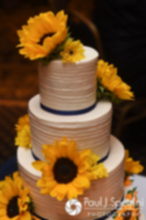 A look at the wedding cake, on display during Kristin and Chris' October 2016 wedding reception at the Ashworth by the Sea Hotel in Hampton, New Hampshire.