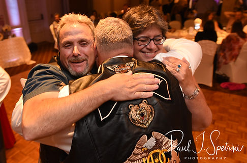Rick gets a hug during his August 2018 wedding reception at Twelve Acres in Smithfield, Rhode Island.