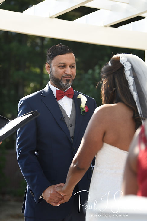 Jimmy looks at Saken during his July 2018 wedding ceremony at Lake Pearl in Wrentham, Massachusetts.