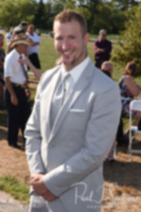 Bryan smiles for a photo prior to his August 2018 wedding ceremony at Fort Phoenix in Fairhaven, Massachusetts.