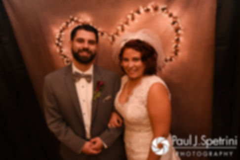 Crystal and Andy pose for a photo during their November 2016 wedding reception at the Salem Cross Inn in West Brookfield, Massachusetts.