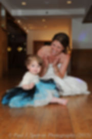 Jamie Bolani plays with her daughter on the dance floor during her June 2015 wedding reception in Bristol, Rhode Island.