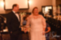 Patti and Bob listen to the maid of honor's speech during their August 2018 wedding reception at the Olde Colonial Cafe in Norwood, Massachusetts.