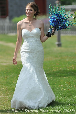 Jamie Bolani walks down the aisle during her wedding ceremony at Prescott Farms in Portsmouth, Rhode Island in June 2015.