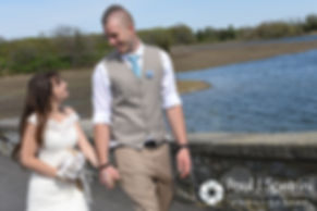 Krystal and Ian take a walk on a bridge for formal photos following their May 2016 wedding at Colt State Park in Bristol, Rhode Island.
