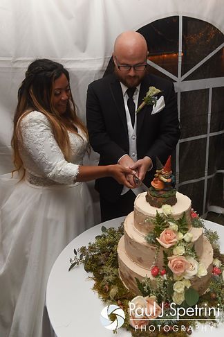 Forrester and Lisajean cut their wedding cake during their October 2016 wedding reception in Charlestown, Rhode Island.