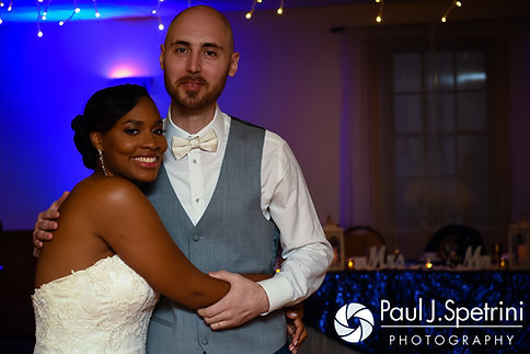 Jennifer and Mark smile for a photo during their September 2016 wedding reception at the RI Shriners and Imperial Room at Rhodes Place in Providence, Rhode Island.