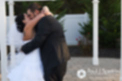 Kelly and Brian share their first kiss during their November 2016 wedding ceremony at the Bay Pointe Club in Buzzards Bay, Massachusetts.