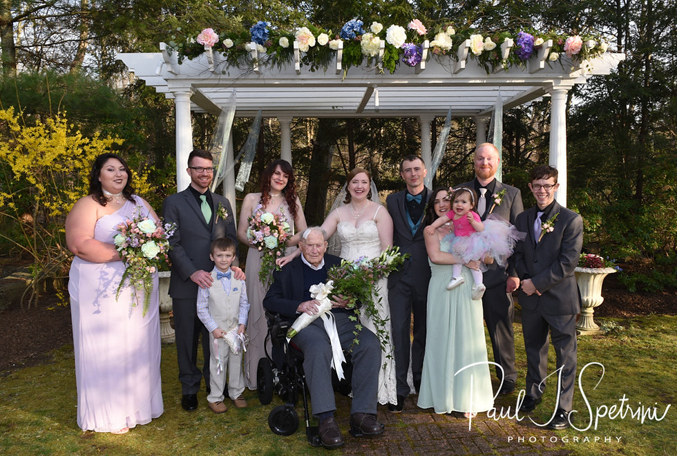 Nate & Kaytii pose for a formal photo with family members following their May 2018 wedding ceremony at Meadowbrook Inn in Charlestown, Rhode Island.