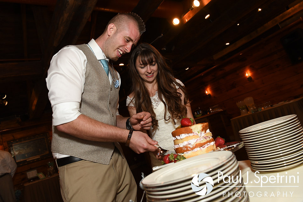 Krystal and Ian cut the cake during their May 2016 wedding reception at DeWolf Tavern in Bristol, Rhode Island.