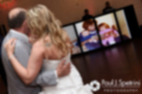 Michelle and her father look at childhood photos during her May 2016 wedding at Hillside Country Club in Rehoboth, Massachusetts.