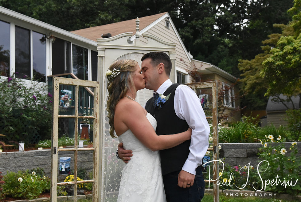 Josh and Kim kiss during Josh & Kim's September 2018 wedding ceremony at their home in Coventry, Rhode Island.
