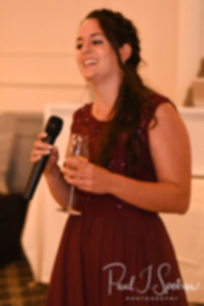 The maid of honor gives a toast during Lizzy & Gabe's September 2018 wedding reception at Crystal Lake Golf Club in Mapleville, Rhode Island.