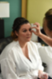 Ashley has her eyelashes put on prior to her September 2018 wedding ceremony at Stepping Stone Ranch in West Greenwich, Rhode Island.