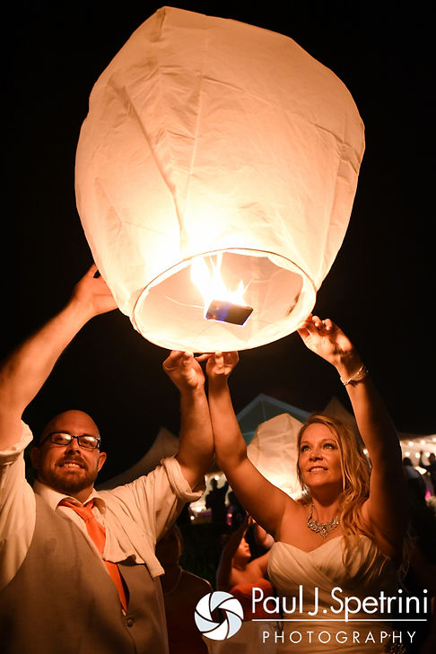 Michelle and Eric release a Chinese lantern during their May 2016 wedding at Hillside Country Club in Rehoboth, Massachusetts.