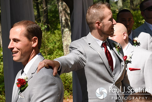 John waits to turn around and see Heather during their July 2016 wedding ceremony at Crystal Lake Golf Club in Burrillville, Rhode Island.