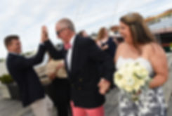 Mike and Kate are introduced during their May 2018 wedding ceremony aboard the Schooner Aurora boat in the waters off Newport, Rhode Island.
