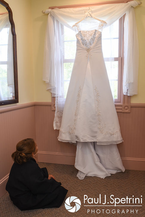 Heather's daughter looks at her mom's dress prior to her July 2016 wedding at Crystal Lake Golf Club in Burrillville, Rhode Island.