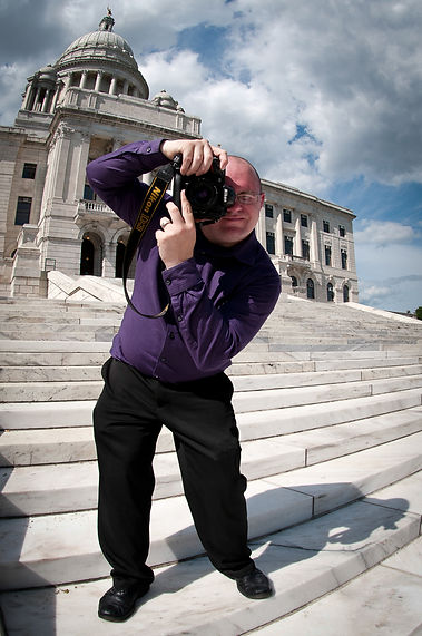 Paul J. Spetrini takes a photo at the Rhode Island State House