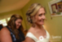 Tricia has her dress zipped up prior to her October 2017 wedding ceremony at St. Brendan Parish in Riverside, Rhode Island.