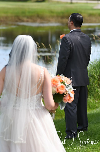 Stephanie and Jacob share a first look prior to their June 2018 wedding ceremony at Foster Country Club in Foster, Rhode Island.