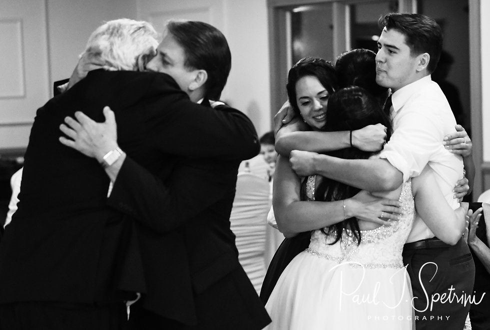 Lizzy and her family embrace during her September 2018 wedding reception at Crystal Lake Golf Club in Mapleville, Rhode Island.