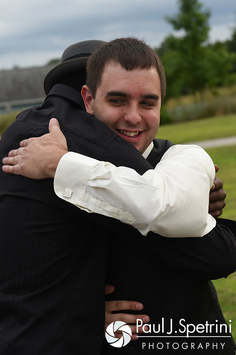 Kyle receives a congratulatory hug following his September 2016 wedding at the Roger Williams Park Botanical Center in Providence, Rhode Island.