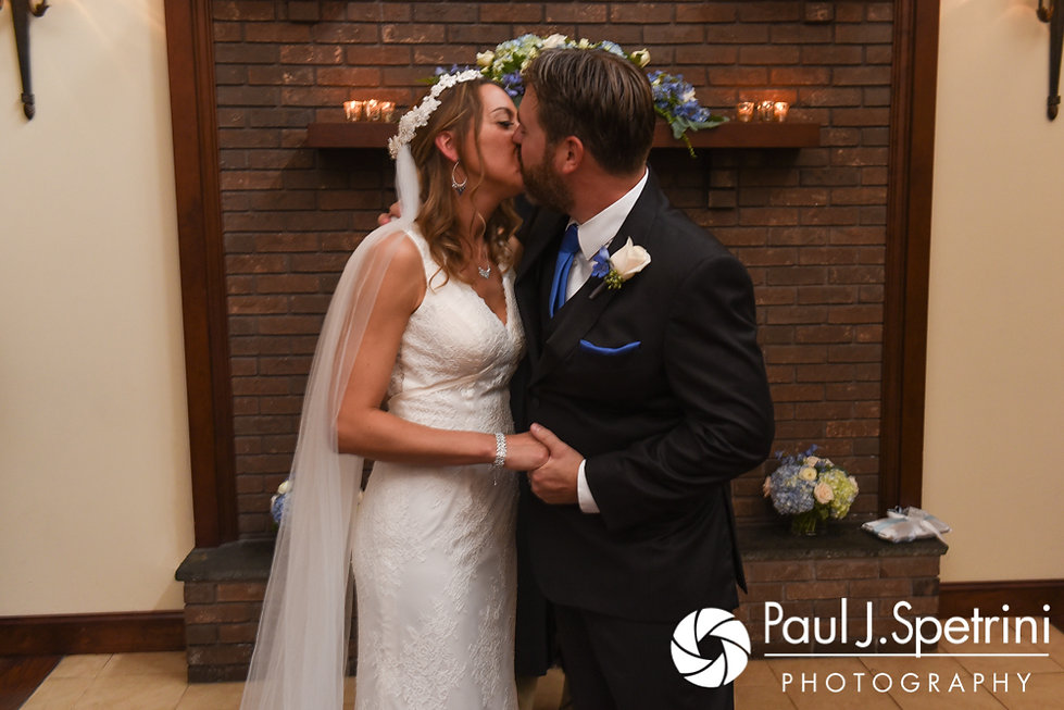 Kevin and Joanna kiss during their October 2017 wedding ceremony at Cranston Country Club in Cranston, Rhode Island.