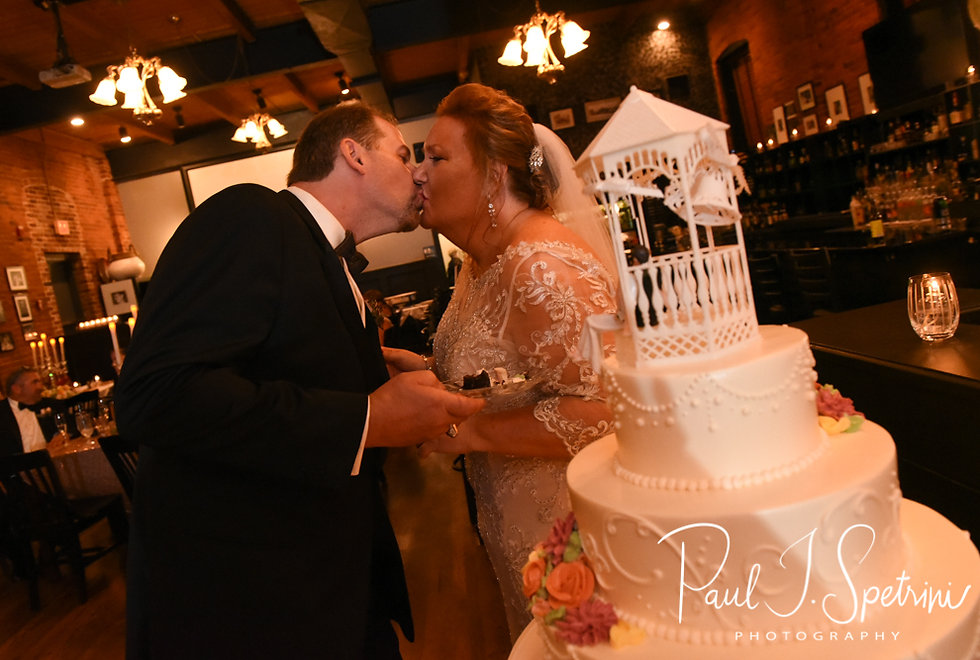 Patti and Bob kiss during their August 2018 wedding reception at the Olde Colonial Cafe in Norwood, Massachusetts.