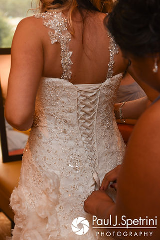 Nicky has her dress tied prior to her September 2017 wedding ceremony at the Crowne Plaza Hotel in Warwick, Rhode Island.