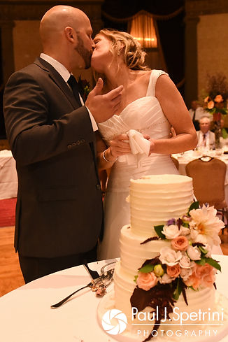 Tricia and Kevin kiss after cutting the cake during their October 2017 wedding reception at the Providence Biltmore in Providence, Rhode Island.