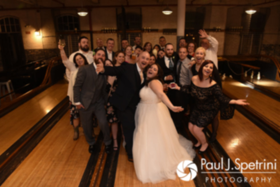 Meridith and Matthew pose for a photo on the bowling alley following their May 2017 wedding reception at the Hope Artiste Village in Pawtucket, Rhode Island.