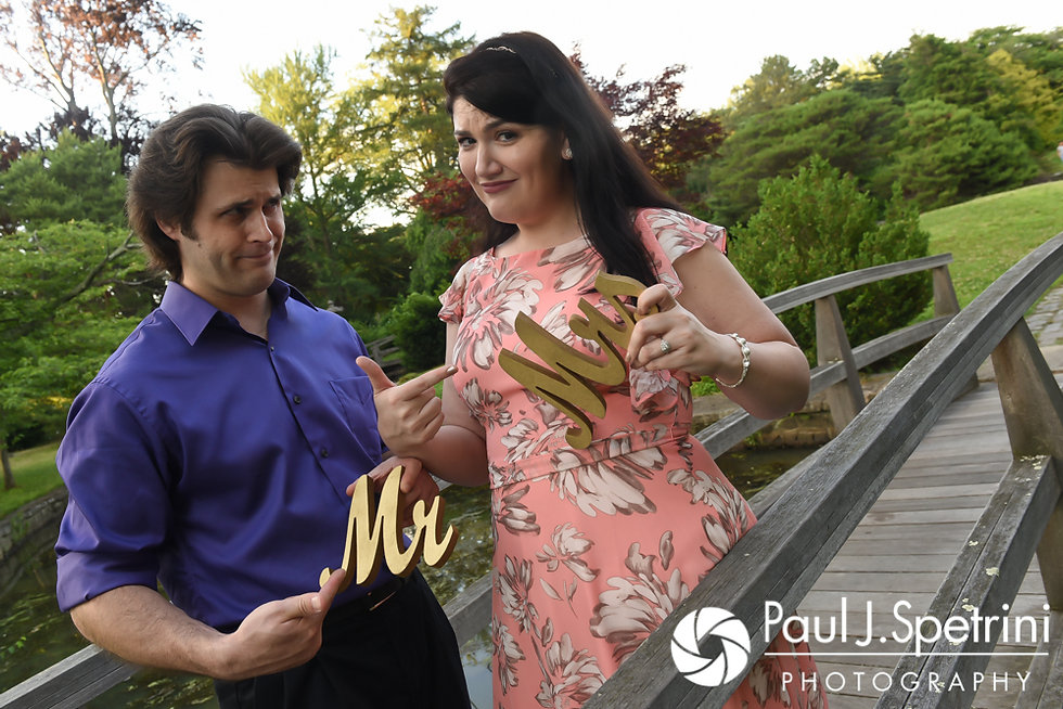 Allison and Len hold props for a photo at the Roger Williams Park Japanese Gardens in Providence, Rhode Island during their June 2017 engagement photo session.