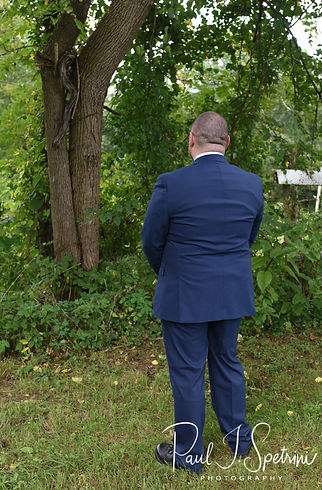 Adam waits for Ashley to arrive to their first look prior to their September 2018 wedding ceremony at Stepping Stone Ranch in West Greenwich, Rhode Island.