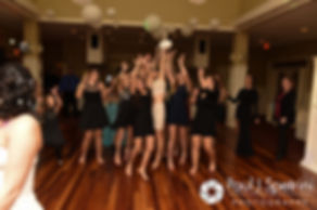 Single ladies jump for the bouquet during Kelly and Brian's November 2016 wedding reception at the Bay Pointe Club in Buzzards Bay, Massachusetts.
