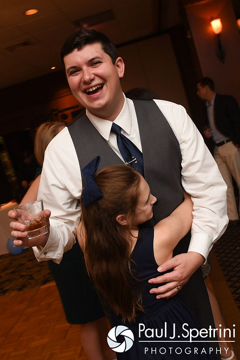 Chris is hugged by a guest during his October 2016 wedding reception at the Ashworth by the Sea Hotel in Hampton, New Hampshire.