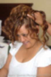 Jean Andrade gets her hair done on her wedding day.