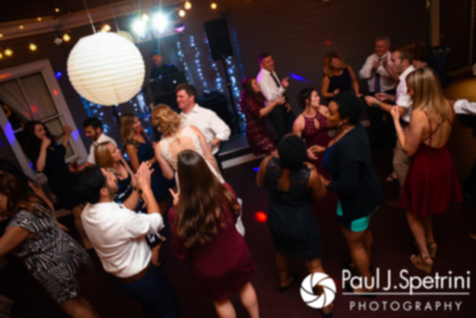 Guests dance during Mike and Rachel's October 2017 wedding reception at Castle Manor Inn in Gloucester, Massachusetts.