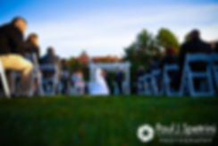 Kelly and Brian listen to their officiant during their November 2016 wedding ceremony at the Bay Pointe Club in Buzzards Bay, Massachusetts.