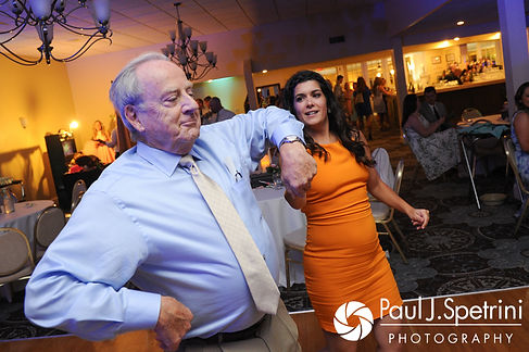 Guests dance during Sean and Cassie's July 2017 wedding reception at Rachel's Lakeside in Dartmouth, Massachusetts.