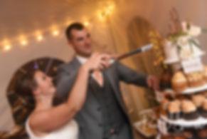 Amanda and Justin cut their wedding cake during their November 2018 wedding reception at Five Bridge Inn in Rehoboth, Massachusetts.